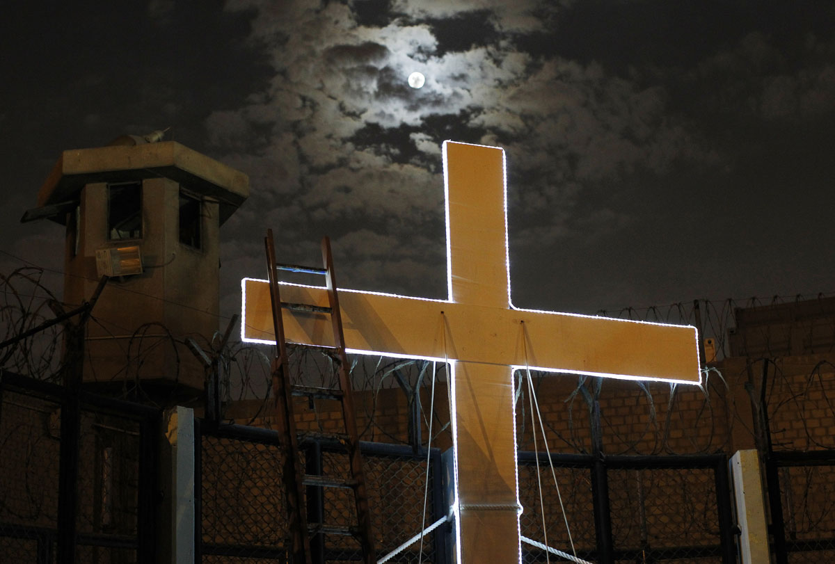 "A cross is seen after the theatre play ""Jesus Christ Superstar"" at Sarita Colonia prison yard, in Lima"